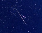 Bright shooting star in the midst of a meteor shower